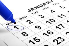Calendar and a marker Stock Photos