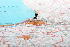 pushpin showing the location of a destination point on a map - stock photo