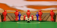 Foosball table one team on a red sky Stock Illustration