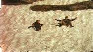 Vintage 8 mm film: Children sliding down glacier, 1970s Stock Footage