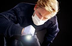 forensic expert searching for evidence - stock photo