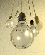 Hanging light bulbs and fittings on a wall Stock Illustration