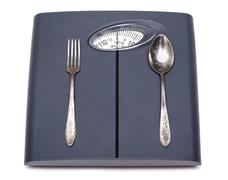 Bathroom scales, fork and spoon Stock Photos