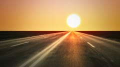 Loopable endless road animation. Low shot. Sunset Stock Footage