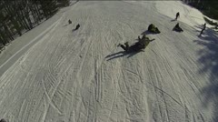Winter Fun Tobogganing on a Snowy Hill Stock Footage