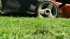 Meadow grass closeup lawn cutter mower worker pass Stock Footage