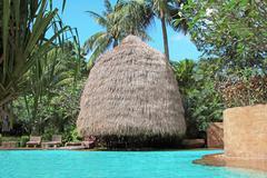 straw bungalow - stock photo