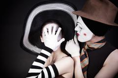 Two mimes in hats Stock Photos