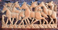 beautiful sculpture of horse made of only one peace of wood - stock photo