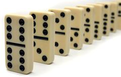 Line of ivory dominos Stock Photos