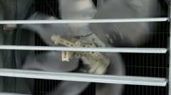 Industrial air fan closeup. Metal blades of air ventilation fan behind grille Stock Footage