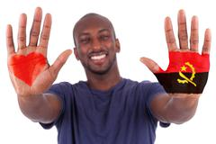 african man hands with a painted heart and angolan flag, i love  angola conce - stock photo
