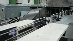 Printed book production line into press plant house Stock Footage