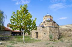 ancient church with green tree and blue sky. st. nikola old church near ancie - stock photo