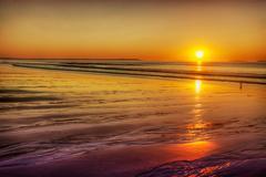 Rising sun on gold sands Stock Photos
