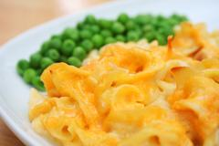 Cheesy noodle casserole dish Stock Photos
