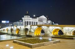 Beautiful old stone bridge and archeological museum of macedonia on star sky Stock Photos