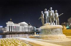 view of archeological museum of macedonia and monument gemidzii with star sky - stock photo