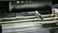 Web offset printing press folding a daily newspaper closeup Stock Footage