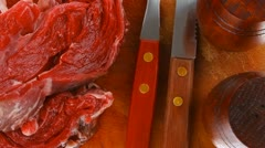 raw steak ready to prepare on cut board with cutlery and castor - stock footage