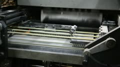 Web offset printing press folding conveyor belt distributing printed and fold Stock Footage