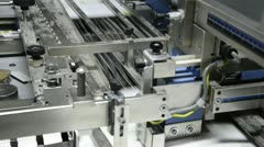Folding machine folds printed offset sheet as part of newspaper brochure in p Stock Footage