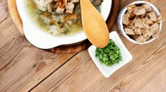 hot fresh diet vegetable soup with rye bread crackers over wood table - stock footage