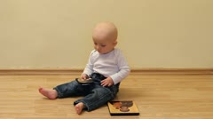 Cute baby with two christian sacred images Stock Footage