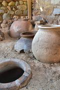Old clay pot excavations into ancient city ruins close up Stock Photos