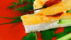 Cheese cannelloni served with vegetables on red plate Stock Footage