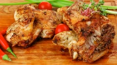Meat food : roasted chicken legs garnished with green sprouts and peppers Stock Footage