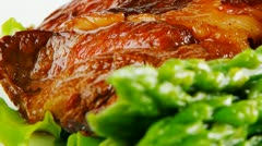 Served roasted beef meat with asparagus on white dish Stock Footage
