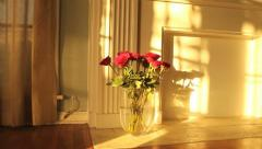 Golden Sunrise Timelapse Over Dozen Romantic Red Roses in Vase Stock Footage