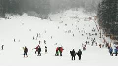 Many people enjoying winter sport, skiing on a snowed slope - stock footage