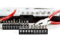 Screwdriver bit set on white with pliers Stock Photos