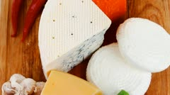 Several soft and hard types of french cheese on wooden board Stock Footage