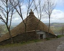 Pallozas on hillside O'Cebreiro, Spain Stock Footage