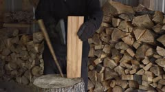 Man Chopping Kindling in Woodshed with Axe - Slow Motion Stock Footage