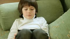Child Playing Computer Games On Tablet Pc Stock Footage
