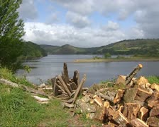 Lake in Galician landscape pan firewood logs -  shed Stock Footage