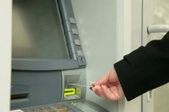 Businesswoman Getting Money At ATM Stock Footage