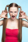 Aggressive girl in red dress Stock Photos