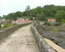 Stone bridge Ponte Macera at Rio Tambre pan - river upstream Stock Footage