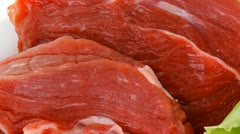Meat chop with slices over white plate Stock Footage