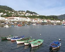 pan - Small fishing boats in Muros harbor at Costa Morte - stock footage