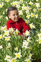 Girl young child playing spring time fun Stock Photos