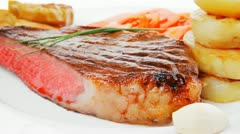 Meat food : roasted fillet on white plate with tomatoes and chives Stock Footage