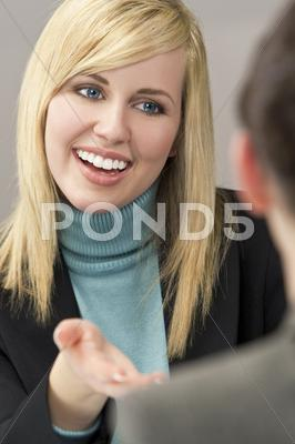 Stock photo of happy business women in a meeting