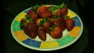 Strawberry: Plate of strawberries time lapse - top view wide Stock Footage