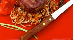 Grilled beef fillet pieces on noodles red hot chili pepper with tomato Stock Footage